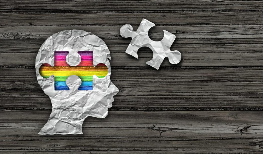 Imagem de uma cabeça com peça de quebra-cabeças faltando