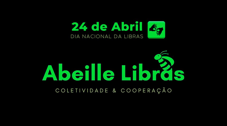 Imagem em fundo escuro e texto em tons de verde, 21 de abril, Dia Nacional da Libras, e logo do app Abeille LIBRAS.